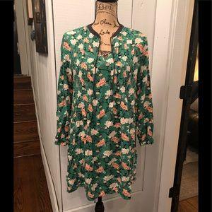Green dress with white and peach floral pattern
